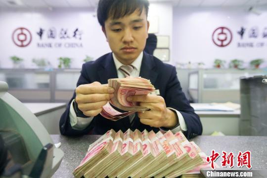 外汇局:2月中国外汇市场总计成交12.83万亿元人民币